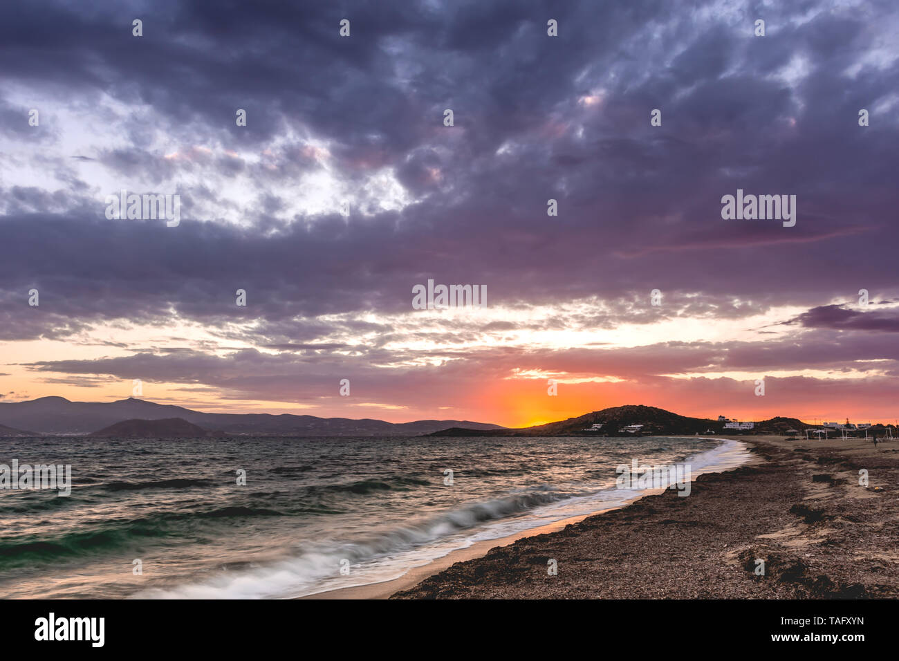 Sunset behind the Cyclades at Agios Prokopios beach, Naxos, Greece Stock Photo