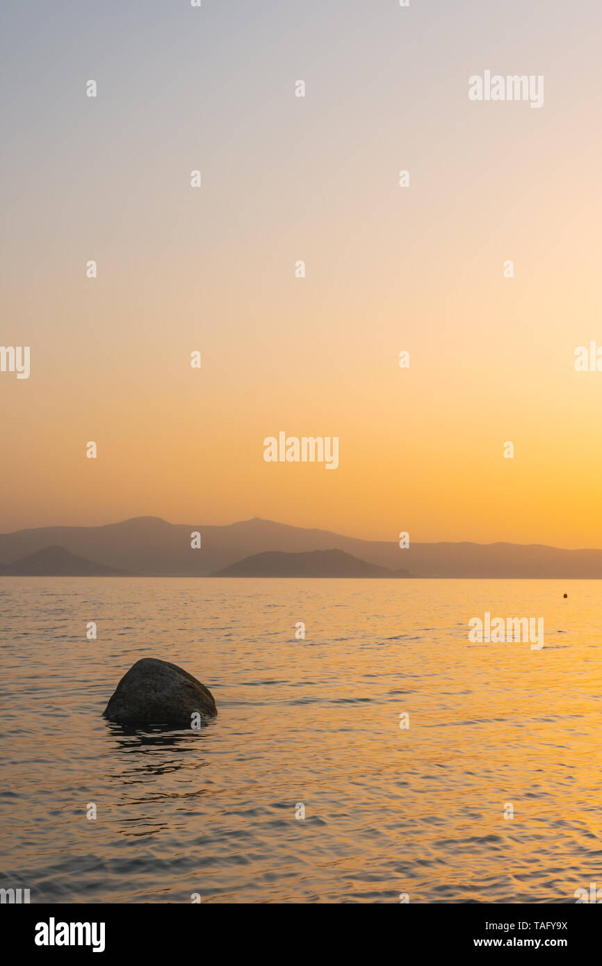 Sunset behind the Cyclades in the Aegean Sea, Naxos, Greece Stock Photo