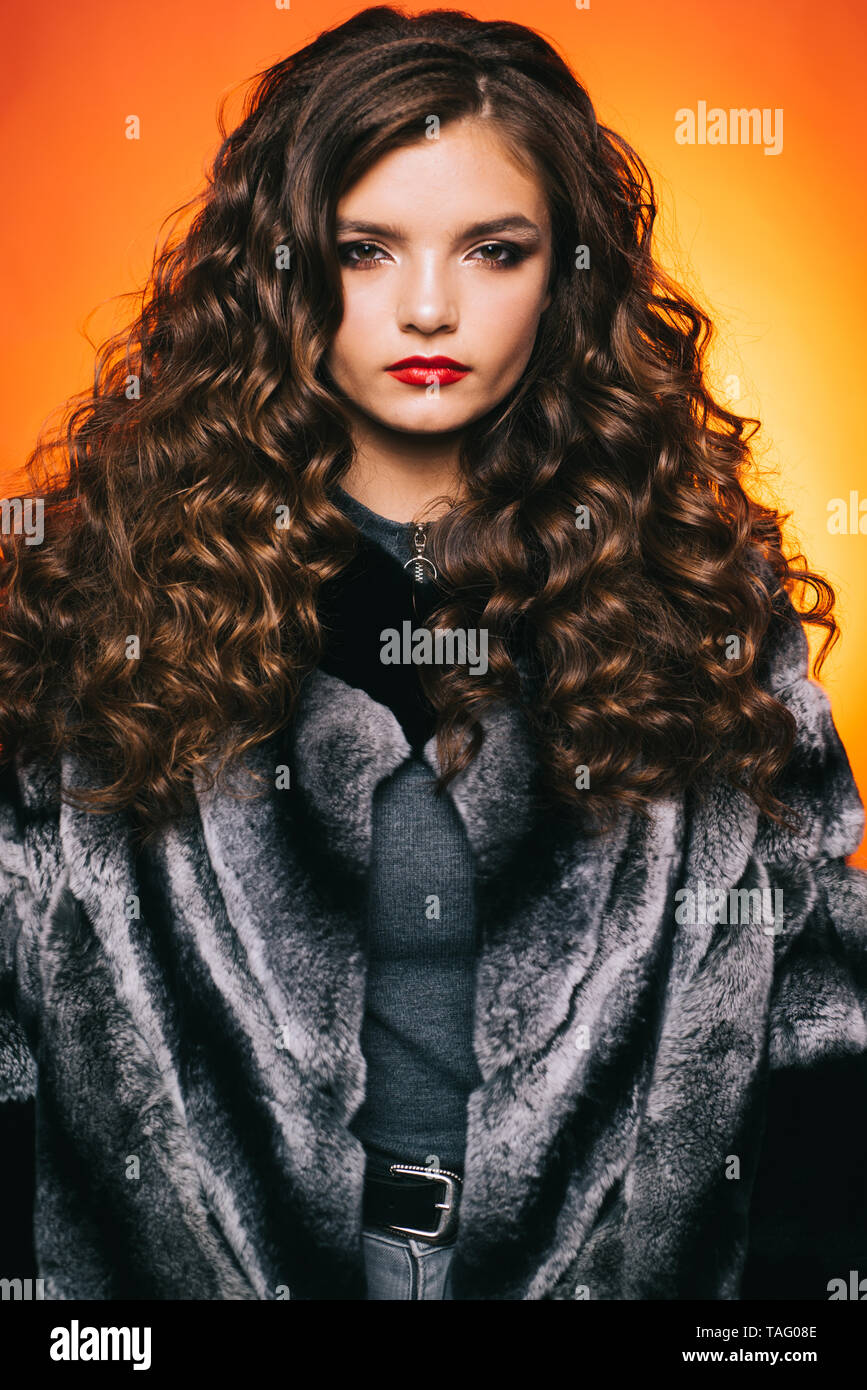 Shaping Curly Hair Young Woman With Long Locks Of Hair