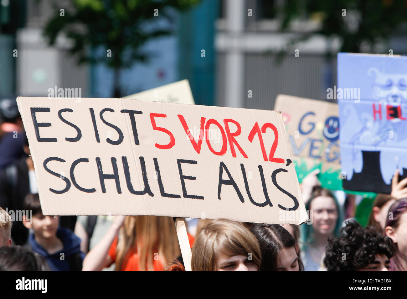 A protester carries a sign that reads 'It's 5 to 12. School's out'. Around 4,500 young people marched through Frankfurt to the European Central Bank, to protest against the climate change and for the introduction of measurements against it. The protest took place as part of an Europe wide climate strike, two days ahead of the 2019 European elections. (Photo by Michael Debets/Pacific Press - Stock Image