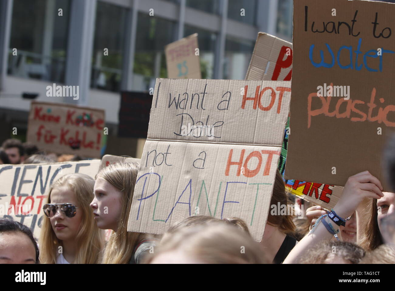 A protester carries a sign that reads 'I want a hot date not a hot planet'. Around 4,500 young people marched through Frankfurt to the European Central Bank, to protest against the climate change and for the introduction of measurements against it. The protest took place as part of an Europe wide climate strike, two days ahead of the 2019 European elections. (Photo by Michael Debets/Pacific Press - Stock Image