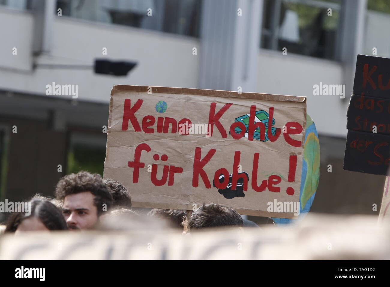 A protester carries a sign that reads 'No money for coal'. It's a wordplay on the German for coal and the colloquial for money being the same word. Around 4,500 young people marched through Frankfurt to the European Central Bank, to protest against the climate change and for the introduction of measurements against it. The protest took place as part of an Europe wide climate strike, two days ahead of the 2019 European elections. (Photo by Michael Debets/Pacific Press - Stock Image