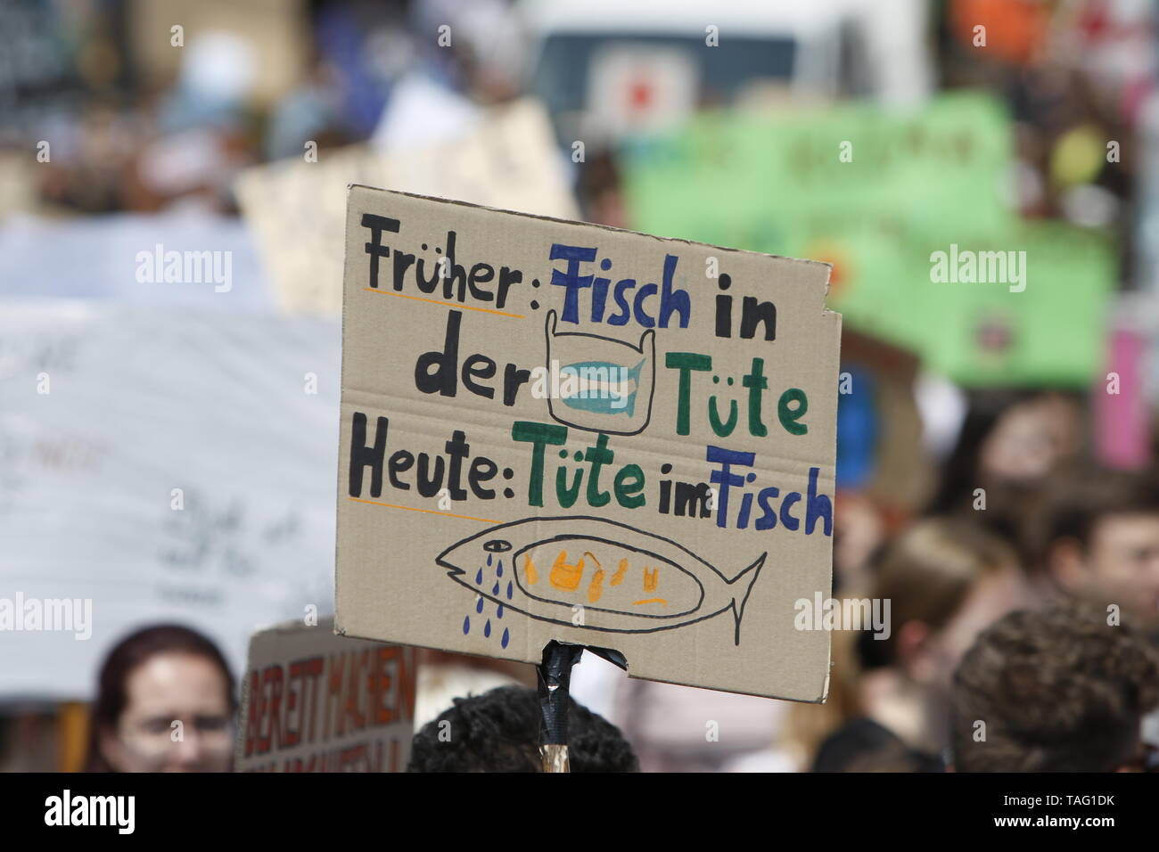 A protester holds a sign that reads 'In the past: fish in a bag - now bag in a fish'. Around 4,500 young people marched through Frankfurt to the European Central Bank, to protest against the climate change and for the introduction of measurements against it. The protest took place as part of an Europe wide climate strike, two days ahead of the 2019 European elections. (Photo by Michael Debets/Pacific Press - Stock Image