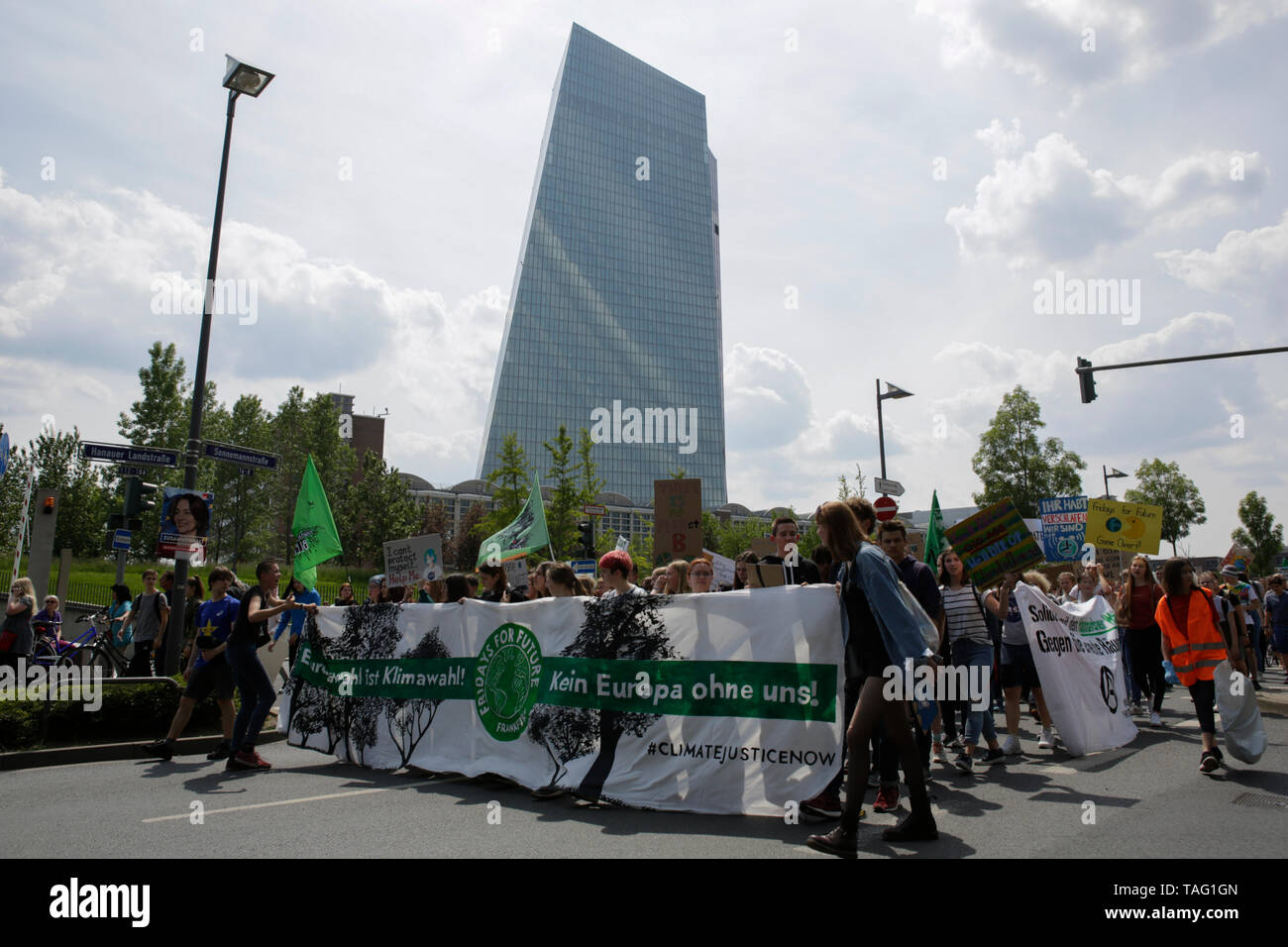 The protesters march with self-made signs past the ECB (European Central Bank) building. Around 4,500 young people marched through Frankfurt to the European Central Bank, to protest against the climate change and for the introduction of measurements against it. The protest took place as part of an Europe wide climate strike, two days ahead of the 2019 European elections. (Photo by Michael Debets/Pacific Press - Stock Image