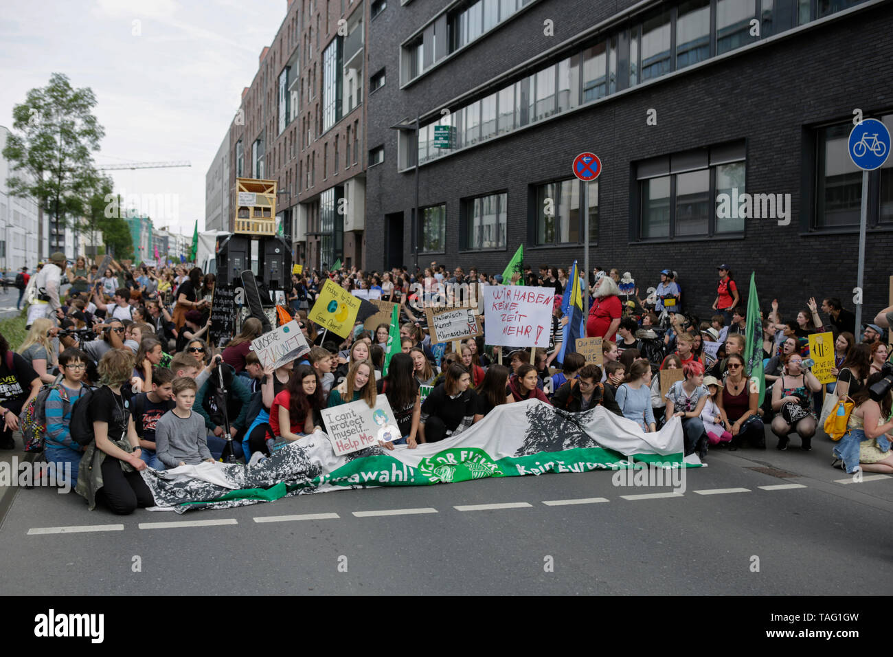 The protesters stage a short sit-in protest. Around 4,500 young people marched through Frankfurt to the European Central Bank, to protest against the climate change and for the introduction of measurements against it. The protest took place as part of an Europe wide climate strike, two days ahead of the 2019 European elections. (Photo by Michael Debets/Pacific Press - Stock Image