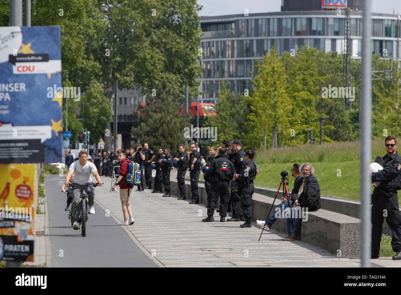 Riot police officers stand around the ECB building to prevent protesters getting on the property. Around 4,500 young people marched through Frankfurt to the European Central Bank, to protest against the climate change and for the introduction of measurements against it. The protest took place as part of an Europe wide climate strike, two days ahead of the 2019 European elections. (Photo by Michael Debets/Pacific Press - Stock Image
