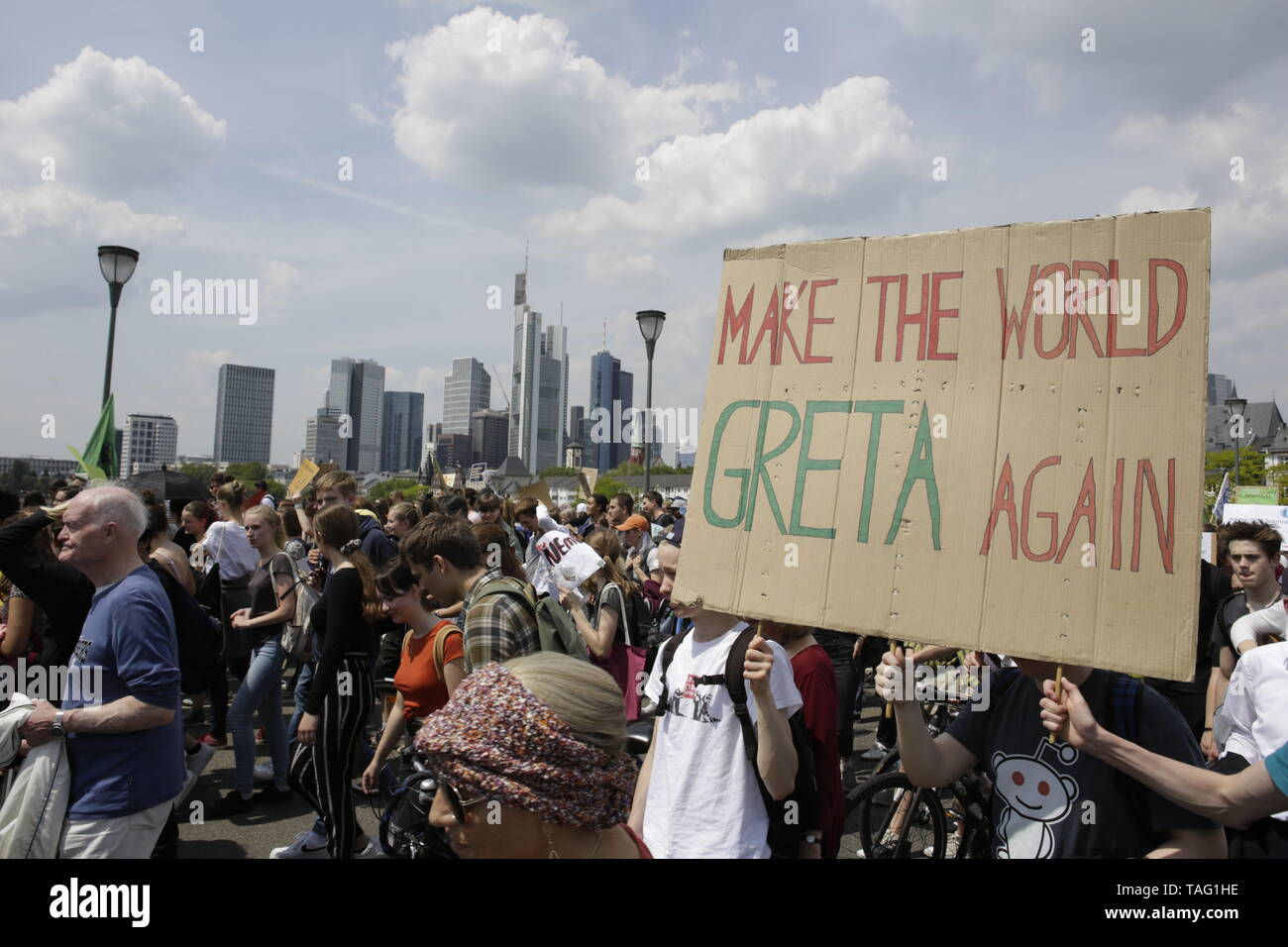 A protester carries a sign that reads 'Mate the World Greta again'. The Frankfurt skyline can be seen in the background. Around 4,500 young people marched through Frankfurt to the European Central Bank, to protest against the climate change and for the introduction of measurements against it. The protest took place as part of an Europe wide climate strike, two days ahead of the 2019 European elections. (Photo by Michael Debets/Pacific Press - Stock Image