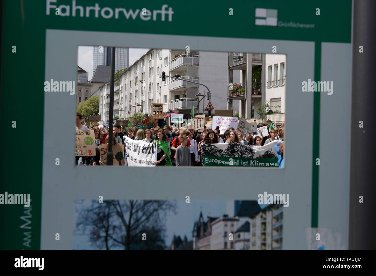 The protest march seen through a tourist sign. Around 4,500 young people marched through Frankfurt to the European Central Bank, to protest against the climate change and for the introduction of measurements against it. The protest took place as part of an Europe wide climate strike, two days ahead of the 2019 European elections. (Photo by Michael Debets/Pacific Press - Stock Image