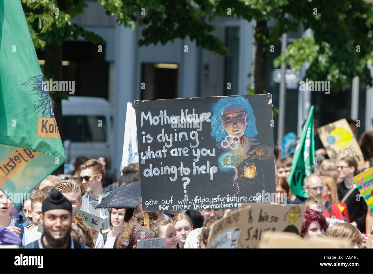 A protester carries a sign that reads 'Mother Nature is dying. What are you doing about'. Around 4,500 young people marched through Frankfurt to the European Central Bank, to protest against the climate change and for the introduction of measurements against it. The protest took place as part of an Europe wide climate strike, two days ahead of the 2019 European elections. (Photo by Michael Debets/Pacific Press - Stock Image