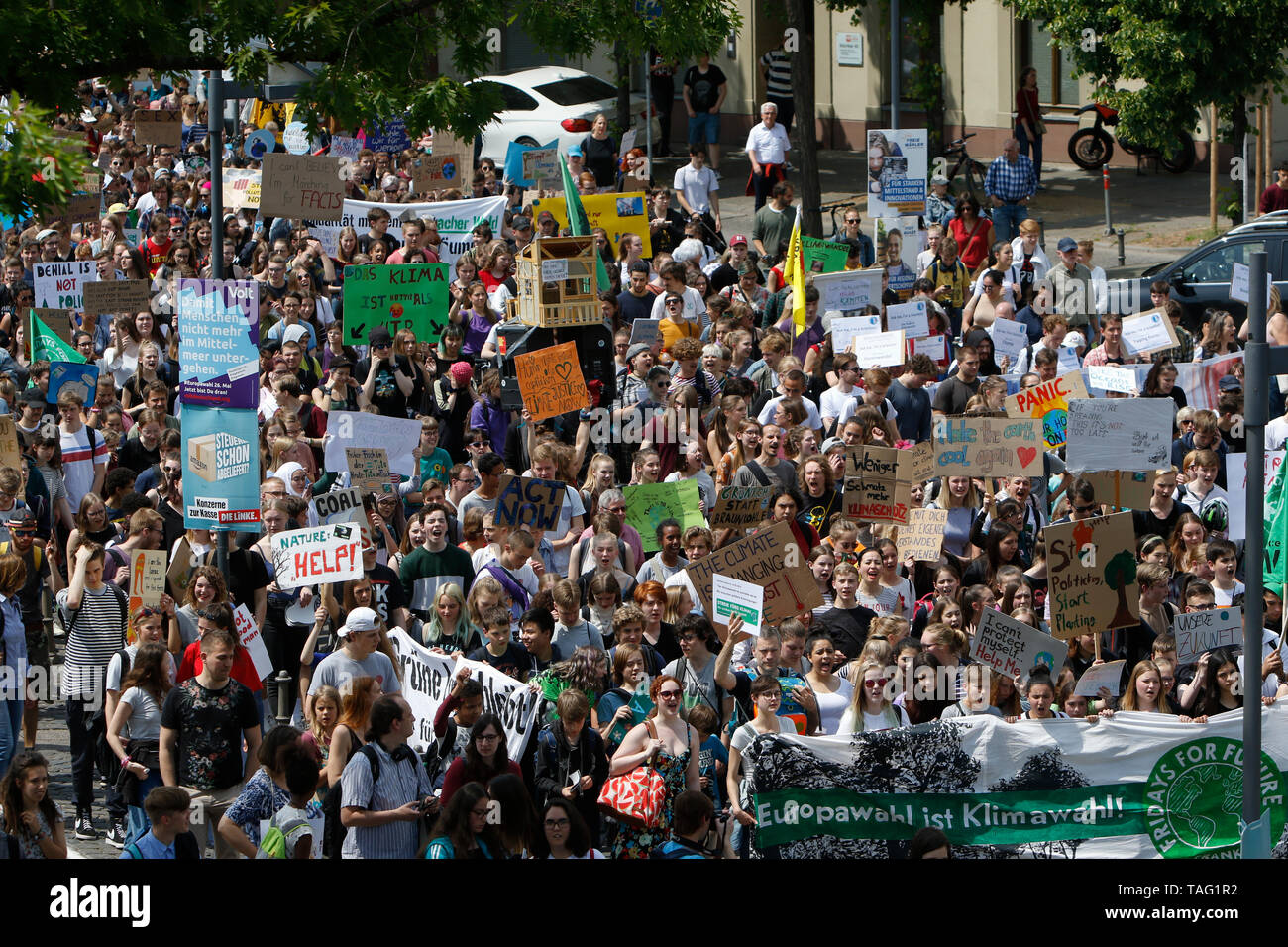 The protesters march with self-made signs through Frankfurt city centre. Around 4,500 young people marched through Frankfurt to the European Central Bank, to protest against the climate change and for the introduction of measurements against it. The protest took place as part of an Europe wide climate strike, two days ahead of the 2019 European elections. (Photo by Michael Debets/Pacific Press - Stock Image