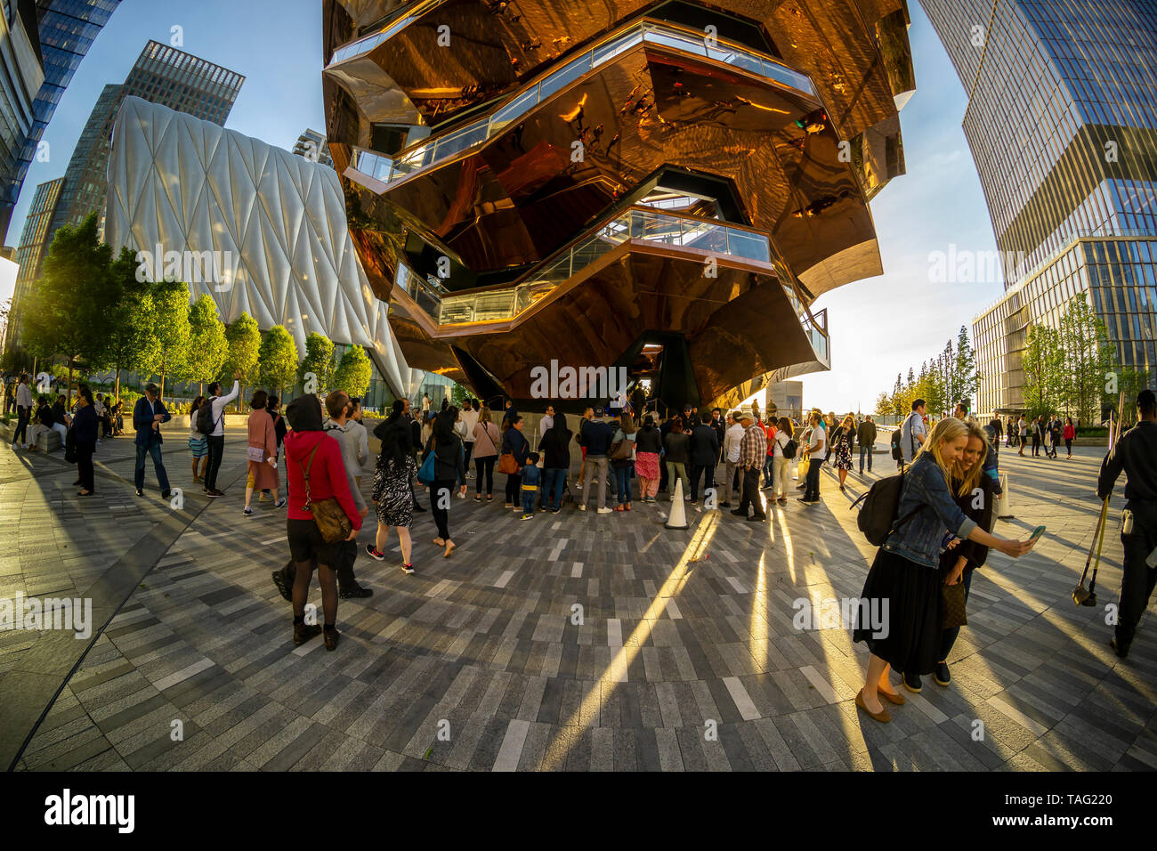 Hordes of visitors flock to Hudson Yards and The Vessel in New York on Tuesday, May 21, 2019. Retailers, including the Neiman Marcus department store, opened their shops in the development which was built on a platform over the West Side railroad yards. Office, residential, public space and retail space comprise the first phase in what is arguably the most expensive construction project ever built in the U.S.   (© Richard B. Levine) Stock Photo