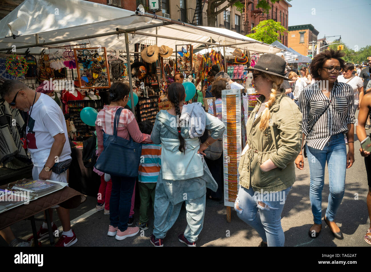 Crowds enjoy the activities afforded them at a street fair in the Park Slope neighborhood of Brooklyn in New York on Sunday, May 19, 2019. (© Richard B. Levine) - Stock Image
