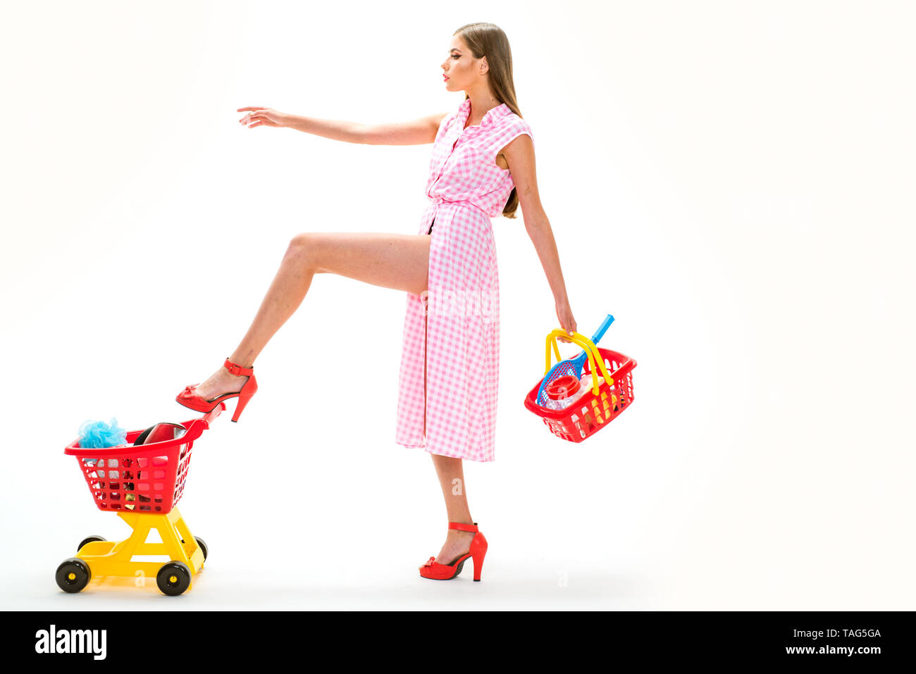 Heavy bags. Easy and fast. vintage housewife woman isolated on white. shopping girl with full cart. woman going to make payment in supermarket. retro  Stock Photo