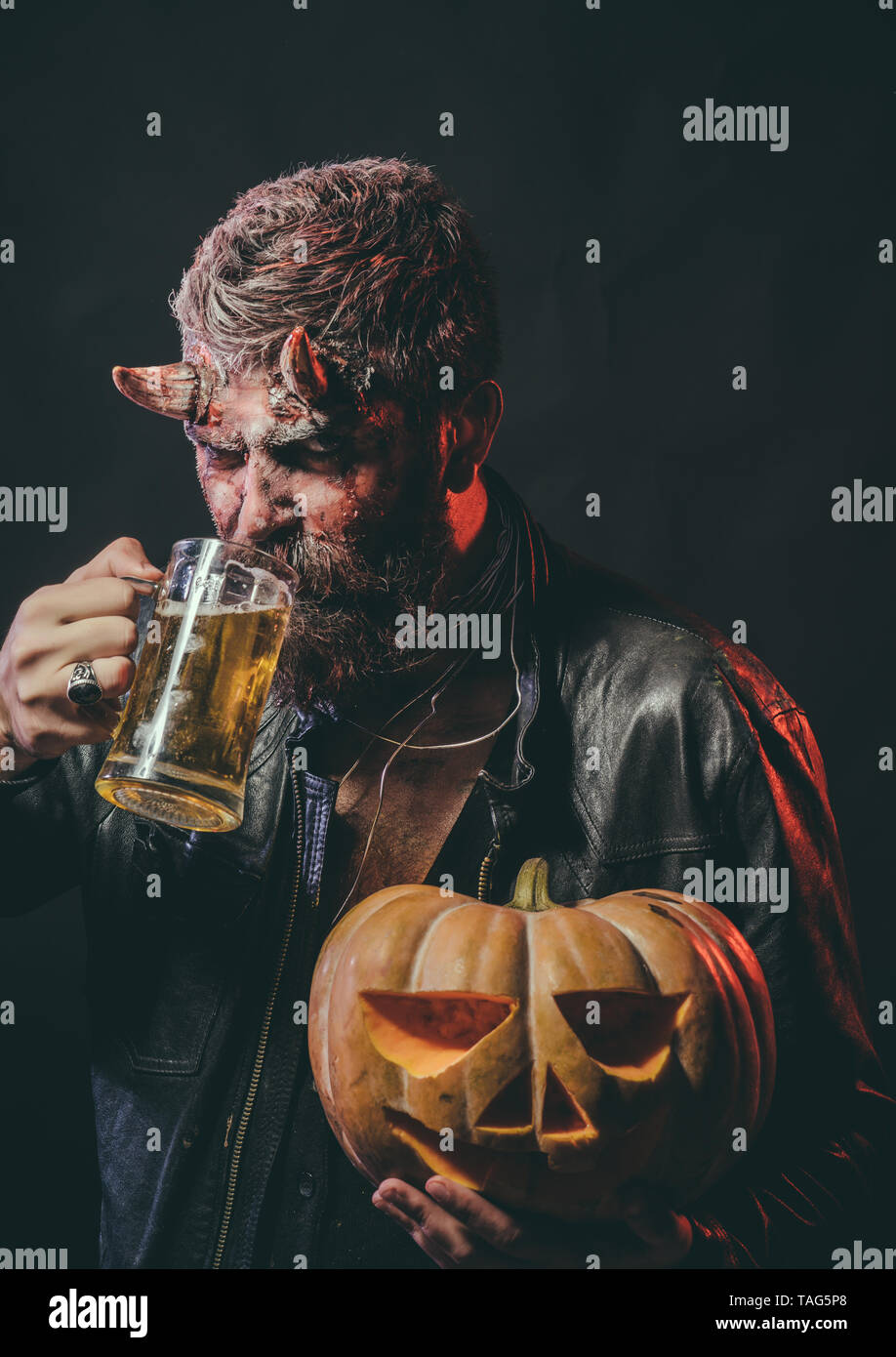 Halloween Maan.Halloween Man With Satan Horns Hold Pumpkin Bad Habits And
