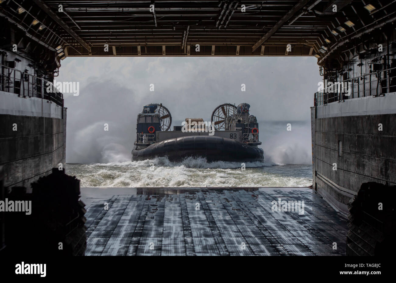 190520-N-FA806-0100  ATLANTIC OCEAN (May 20, 2019) A landing craft, air cushion, assigned to Assault Craft Unit 4 (ACU 4), enters the well deck of the San Antonio-class amphibious transport dock ship USS New York (LPD 21) May 20, 2019. New York is currently underway heading to Fleet Week New York. Fleet Week New York, now in its 31st year, is the city's time-honored celebration of the sea services. It is an unparalleled opportunity for the citizens of New York and surrounding tri-state area to meet Sailors, Marines and Coast Guardsmen, as well as witness firsthand the latest capabilities of to - Stock Image