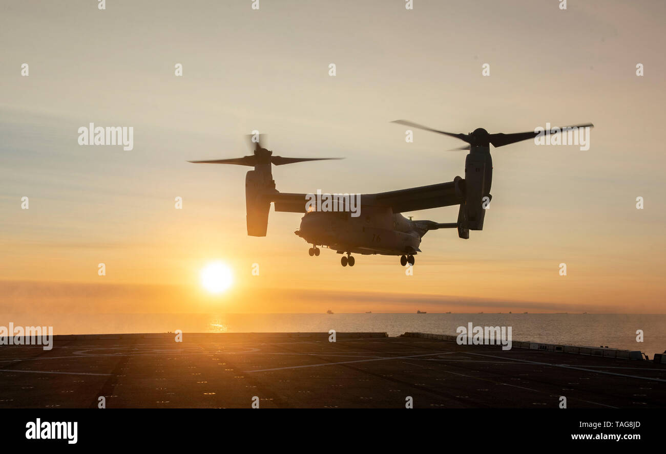 190522-N-FA806-0022  ATLANTIC OCEAN (May 22, 2019) An MV-22 Osprey, attached to Marine Medium Tiltrotor Squadron 263 (VMM-263) lands onboard the San Antonio-class amphibious transport dock ship USS New York (LPD 21). The ship is currently in New York City for Fleet Week New York. Fleet Week New York, now in its 31st year, is the city's time-honored celebration of the sea services. It is an unparalleled opportunity for the citizens of New York and surrounding tri-state area to meet Sailors, Marines and Coast Guardsmen, as well as witness firsthand the latest capabilities of today's maritime ser - Stock Image