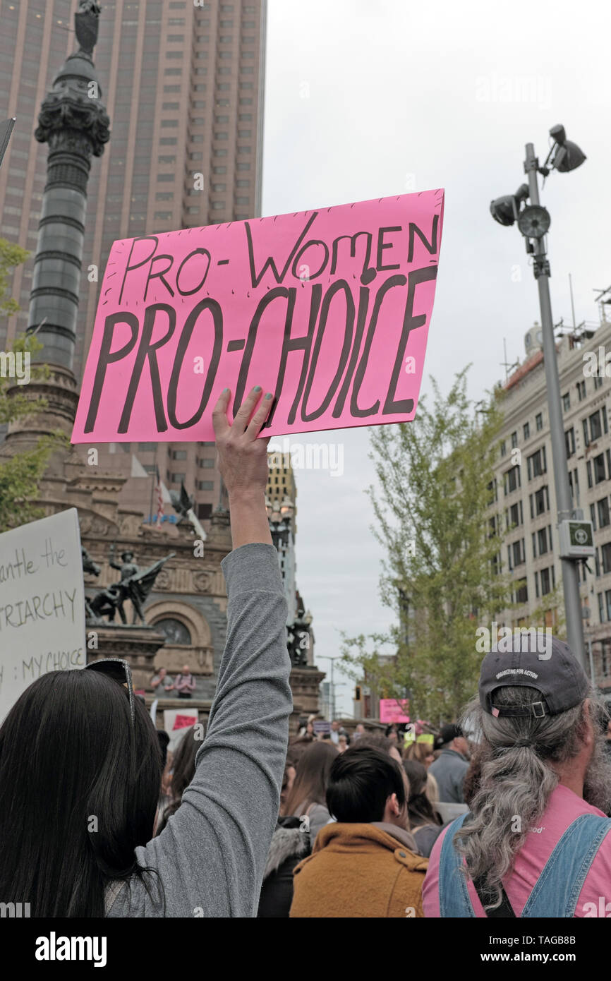 A woman holds a pro-women/pro-choice sign during a pro-choice rally protesting changes in Ohio abortion laws threatening reproductive rights of women. - Stock Image