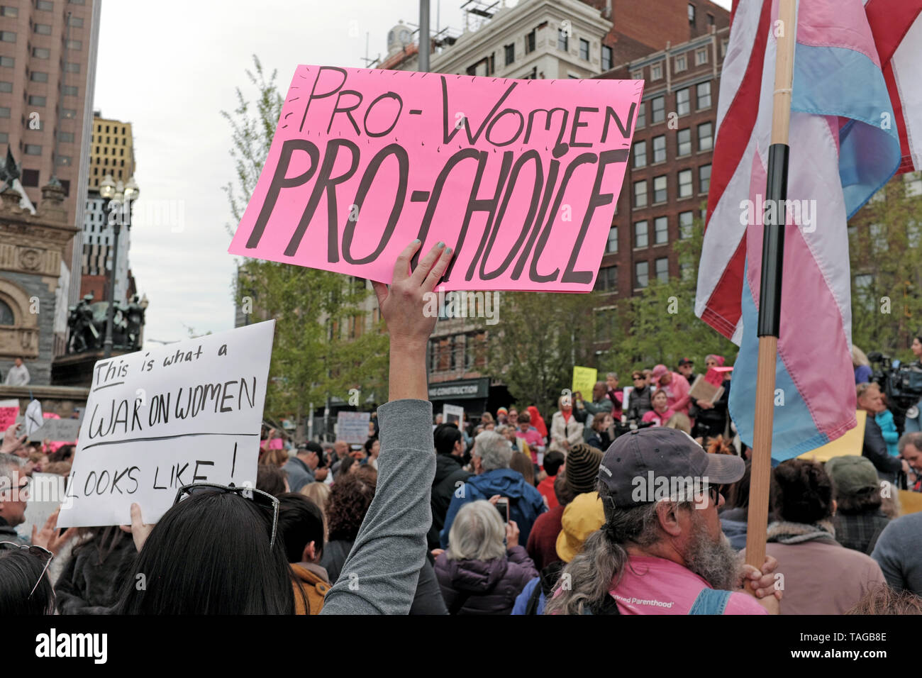 A woman holds a pro-women/pro-choice sign during a pro-choice rally protesting changes in Ohio abortion laws threatening reproductive rights of women. Stock Photo