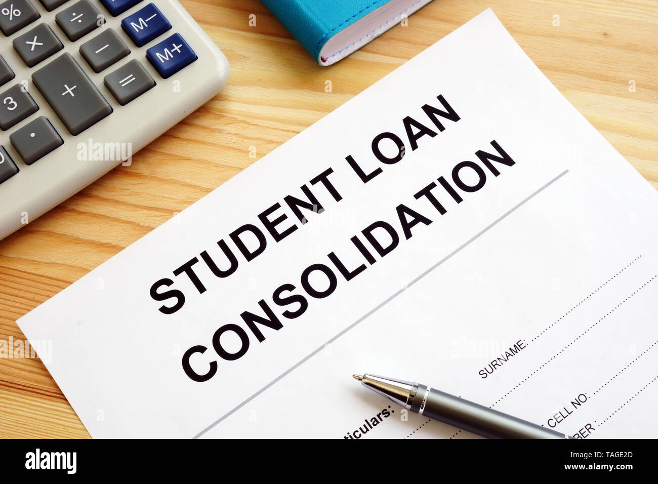 Student Loan Consolidation application, calculator and pen. - Stock Image