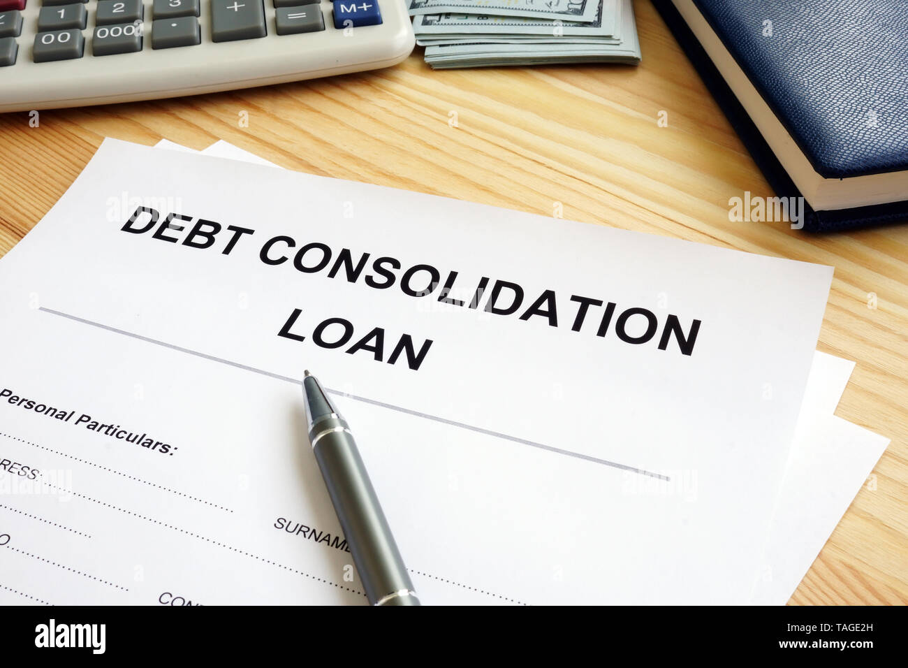 Debt consolidation loan concept. Stack of papers in the office. - Stock Image