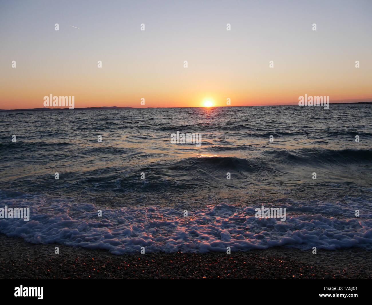 Sunset on the Adriatic coast Stock Photo