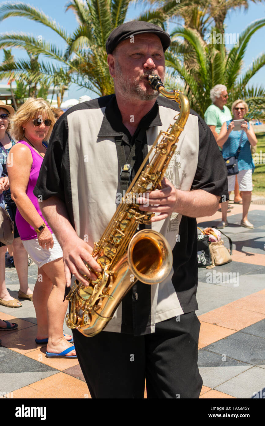 Saxophone player entertaining crowds La Carihuela, Torremolinos, Costa Del Sol, Spain - Stock Image