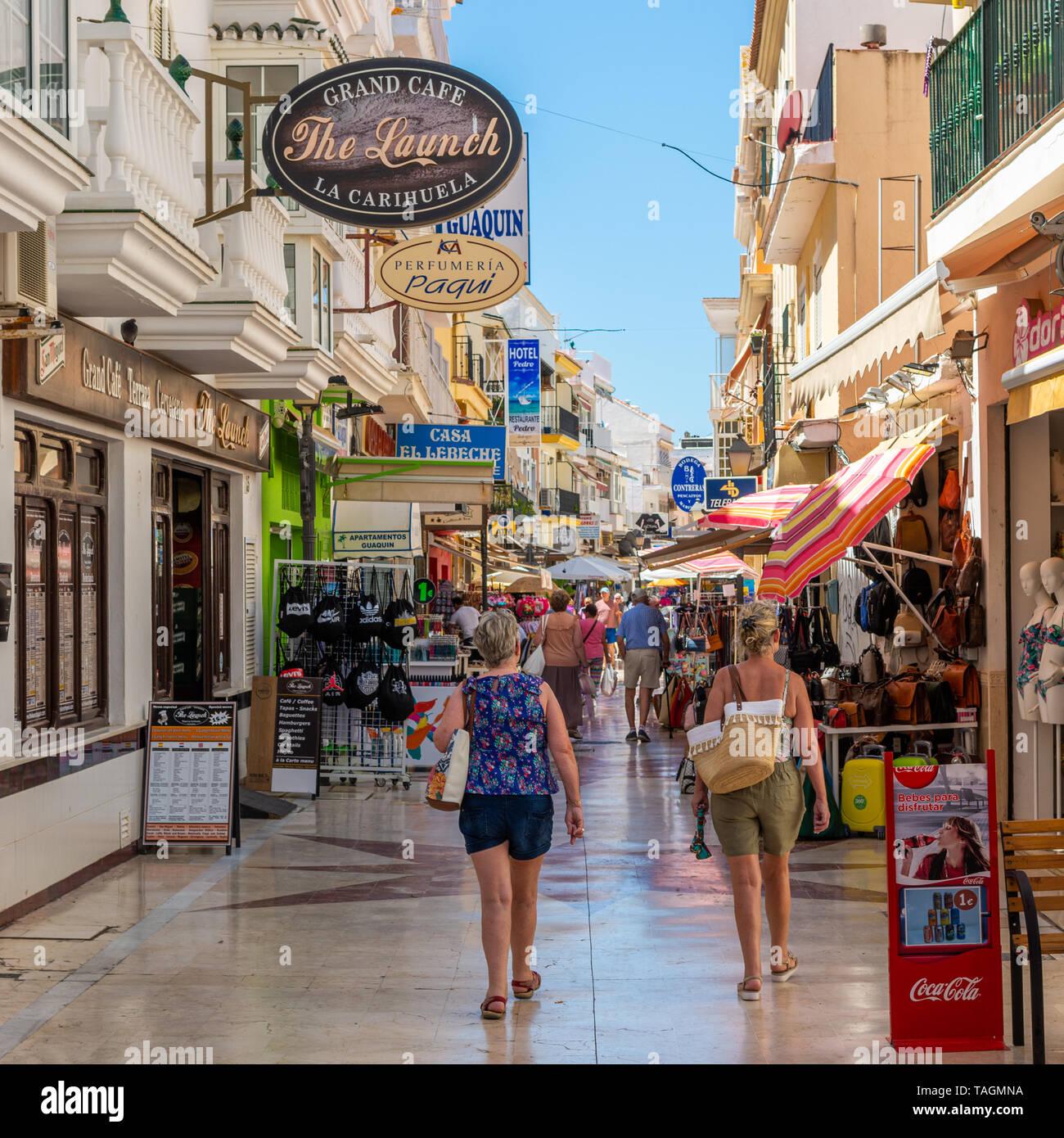 Shops, bars, cafes and restaurants in a pedestrian precinct in La Carihuela, Torremolinos, Costa Del Sol, Spain - Stock Image