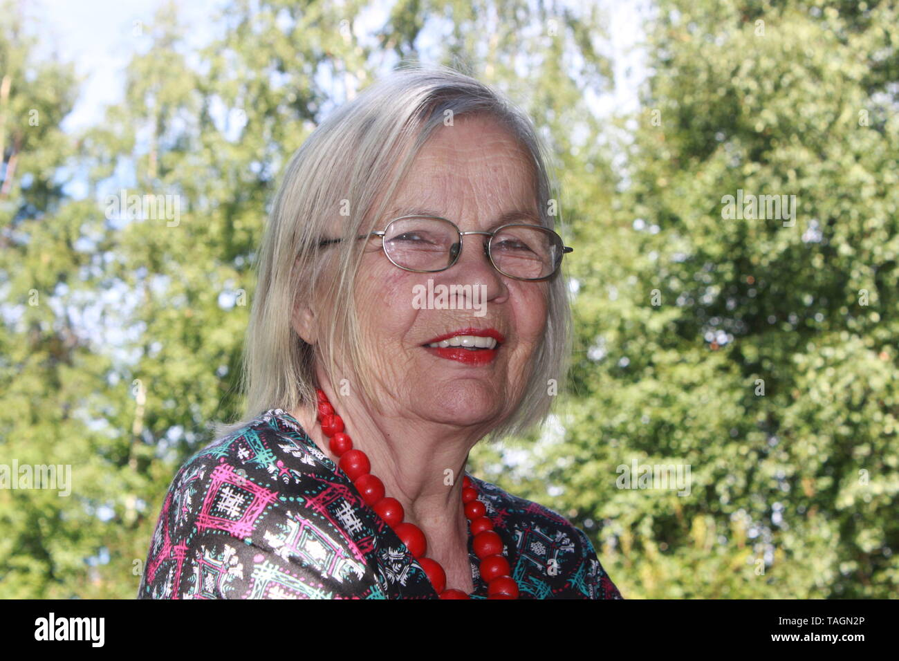 Glamorous older Finnish lady in summer - Stock Image
