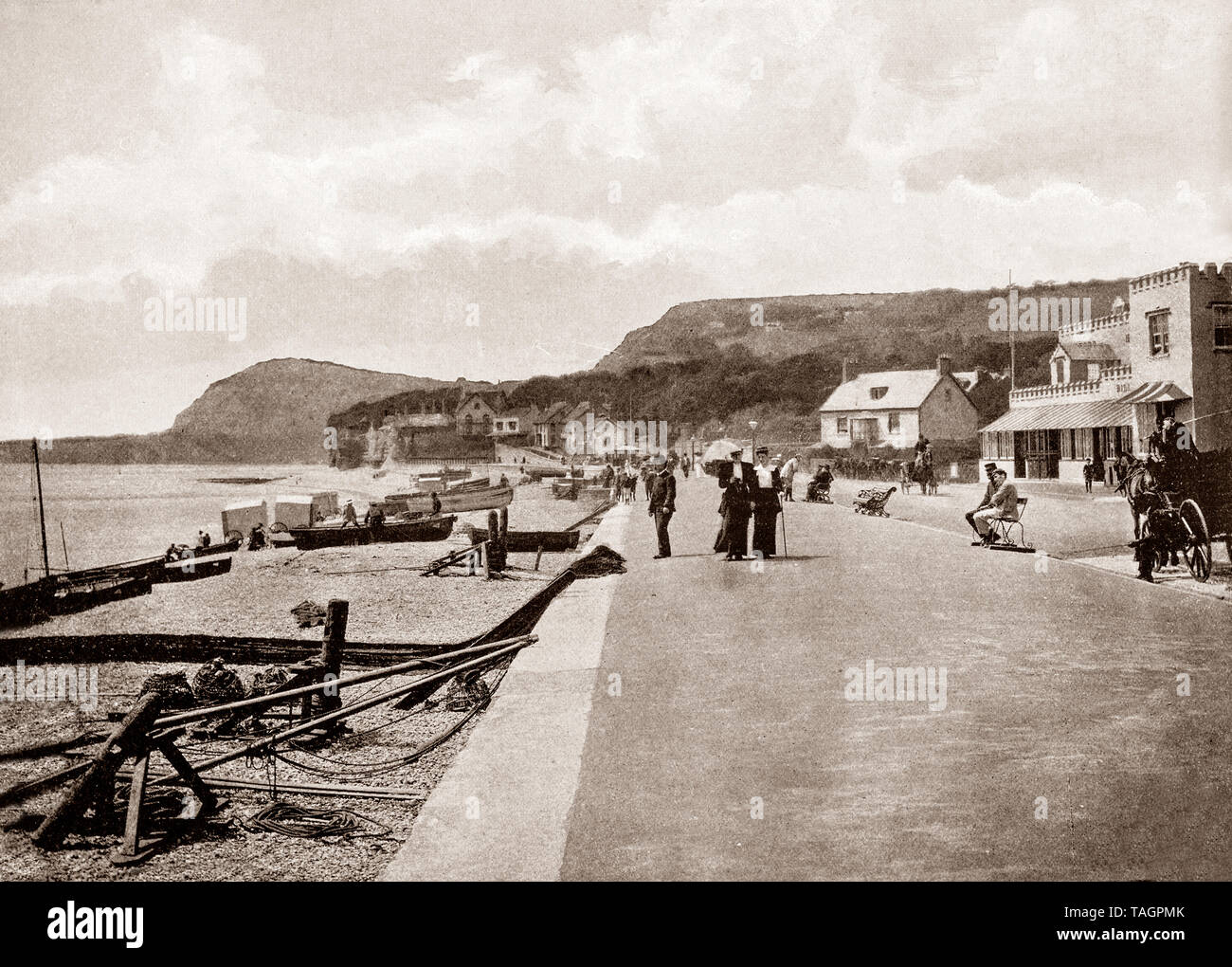 A late 19th Century view of  the shore and seafront at Sidmouth,  a town situated on the English Channel coast in Devon, South West England. It remained a village until the fashion for coastal resorts grew in the Georgian and Victorian periods of the 18th and 19th centuries. A number of Georgian and Regency buildings still remain. In 1874, Sidmouth was connected to the railway network by a branch line contibuting to the growth in visitors and tourists. - Stock Image