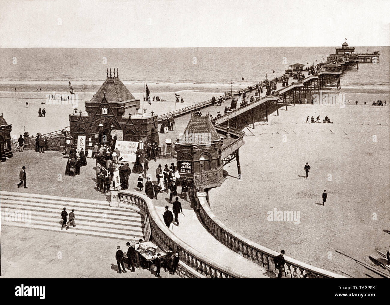 A late 19th Century view of Skegness pier opened on Whit Monday in June 1881 by the Duke of Edinburgh Alfred, Duke of Saxe-Coburg and Gotha and was at the time the fourth longest in England, at a length of 614 yards (561 m) long. Skegness is a seaside town  on the Lincolnshire coast of the North Sea, England, - Stock Image