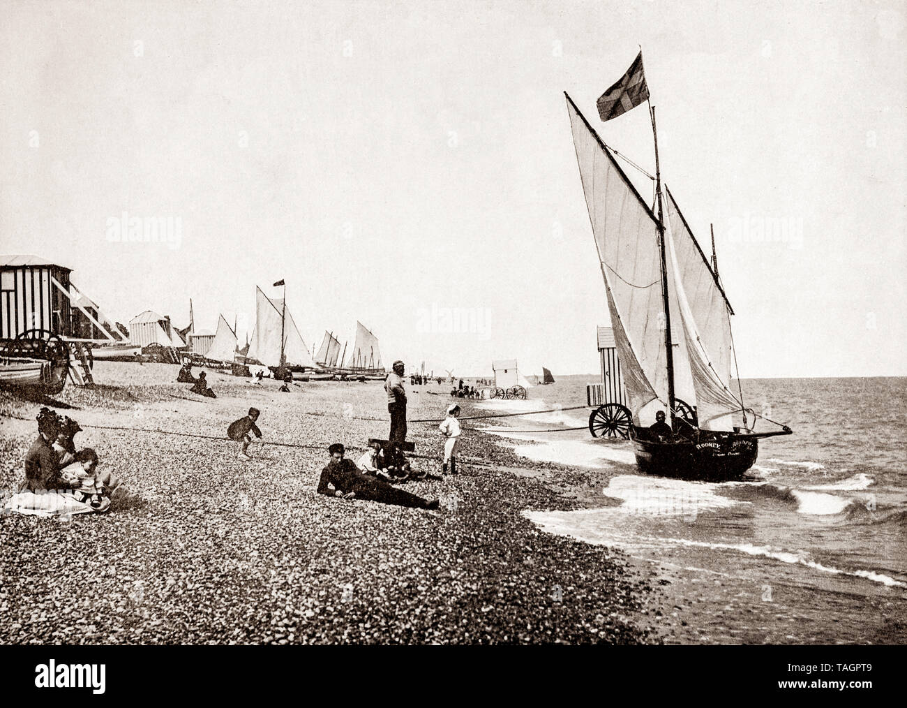 A late 19th Century view of  yachts from the beach at Aldeburgh, an English town on the North Sea coast in the county of Suffolk, to the north of the River Alde. Originally Aldeburgh was a leading Tudor port, and had a flourishing ship-building industry, but its importance as a port declined as the River Alde silted up and larger ships could no longer berth. It survived mainly on fishing until the 19th century, when it also became a seaside resort. - Stock Image