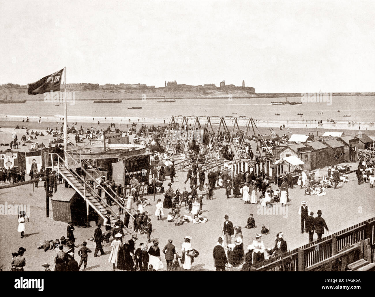 A late 19th Century view of fair ground attractions on the beach in South Shields, an industrial coastal town County Durham, in the North East of England. Located at the mouth of the River Tyne in became a popular tourist resort towards the end of the century. - Stock Image