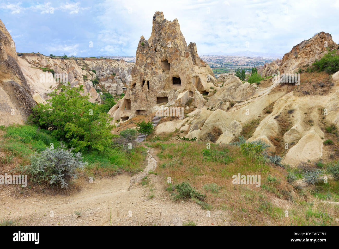 Antique landscape and view of ancient cone-shaped residential caves in the mountain landscape in the valleys of Cappadocia central Turkey - Stock Image