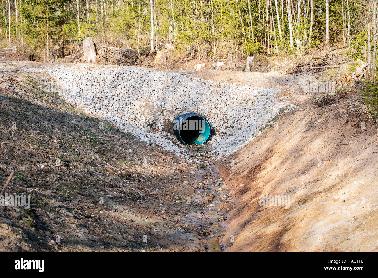 Culvert tube in the countryside - Stock Image