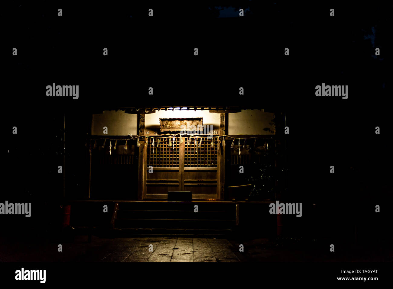 Takayama, Japan - April 8, 2019: Higashiyama Hakusan Shrine in Gifu Prefecture with entrance to temple building in dark night creepy spooky - Stock Image
