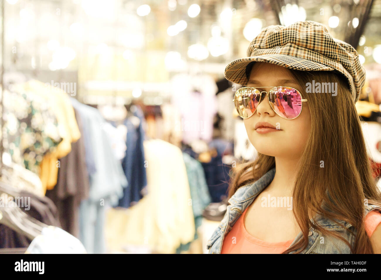 13d822a84409 Pretty 12 year old girl blonde with long hair in a shopping center for  shopping -