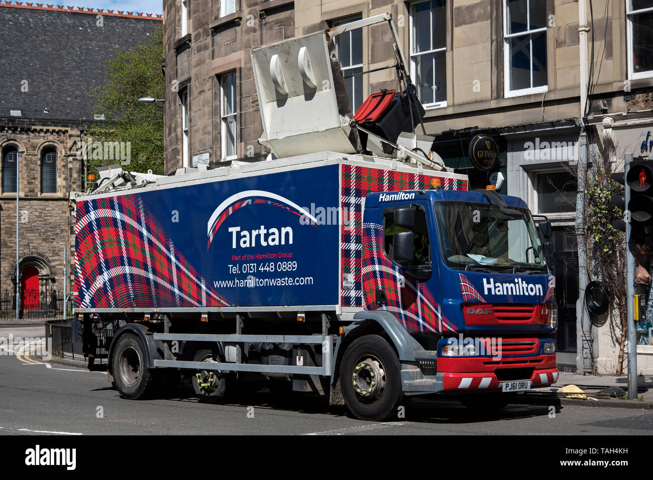 A tartan themed waste and recycling HGV belonging to Hamilton Waste making a collection in Edinburgh, Scotland, UK. - Stock Image