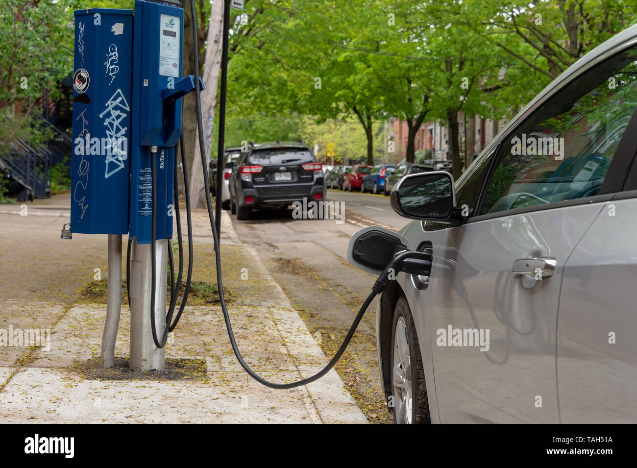 Montreal, CA - 25 May 2019: Chevrolet Volt electric car plugged into an EV charging station. - Stock Image