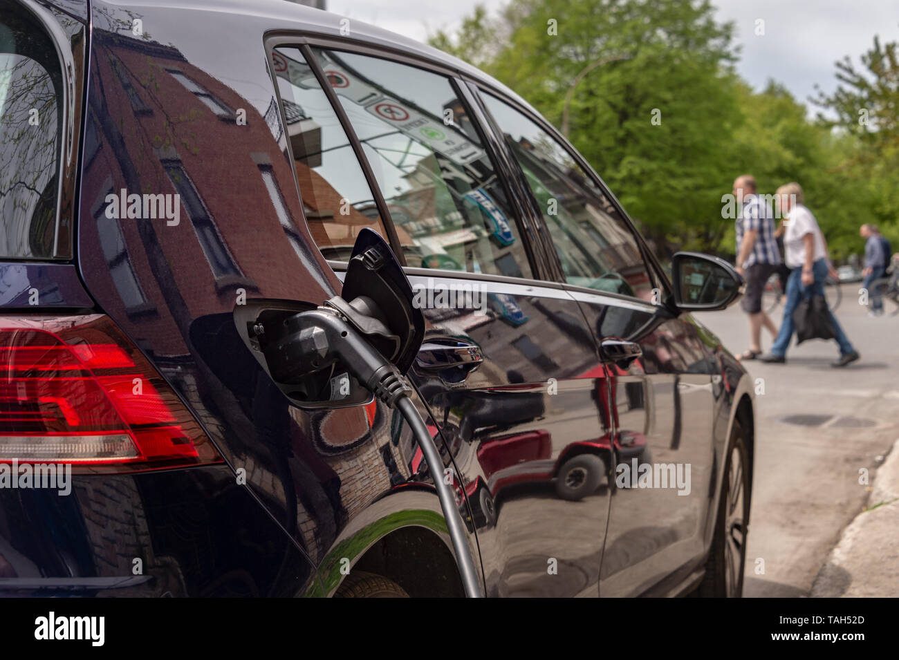 Montreal, CA - 25 May 2019: Electric car plugged into an EV charging station. - Stock Image