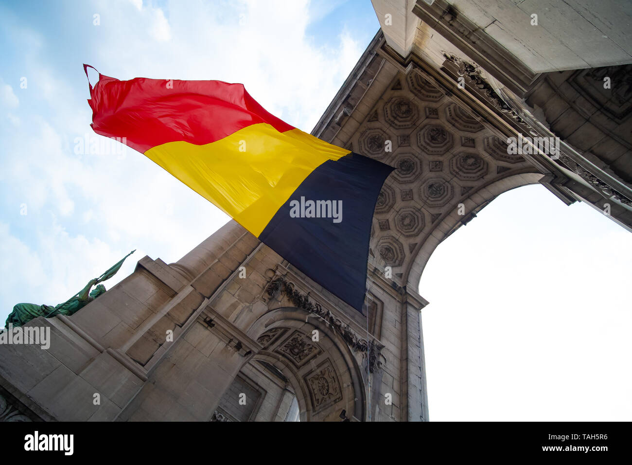Belgian flag blowing Under an arch Stock Photo