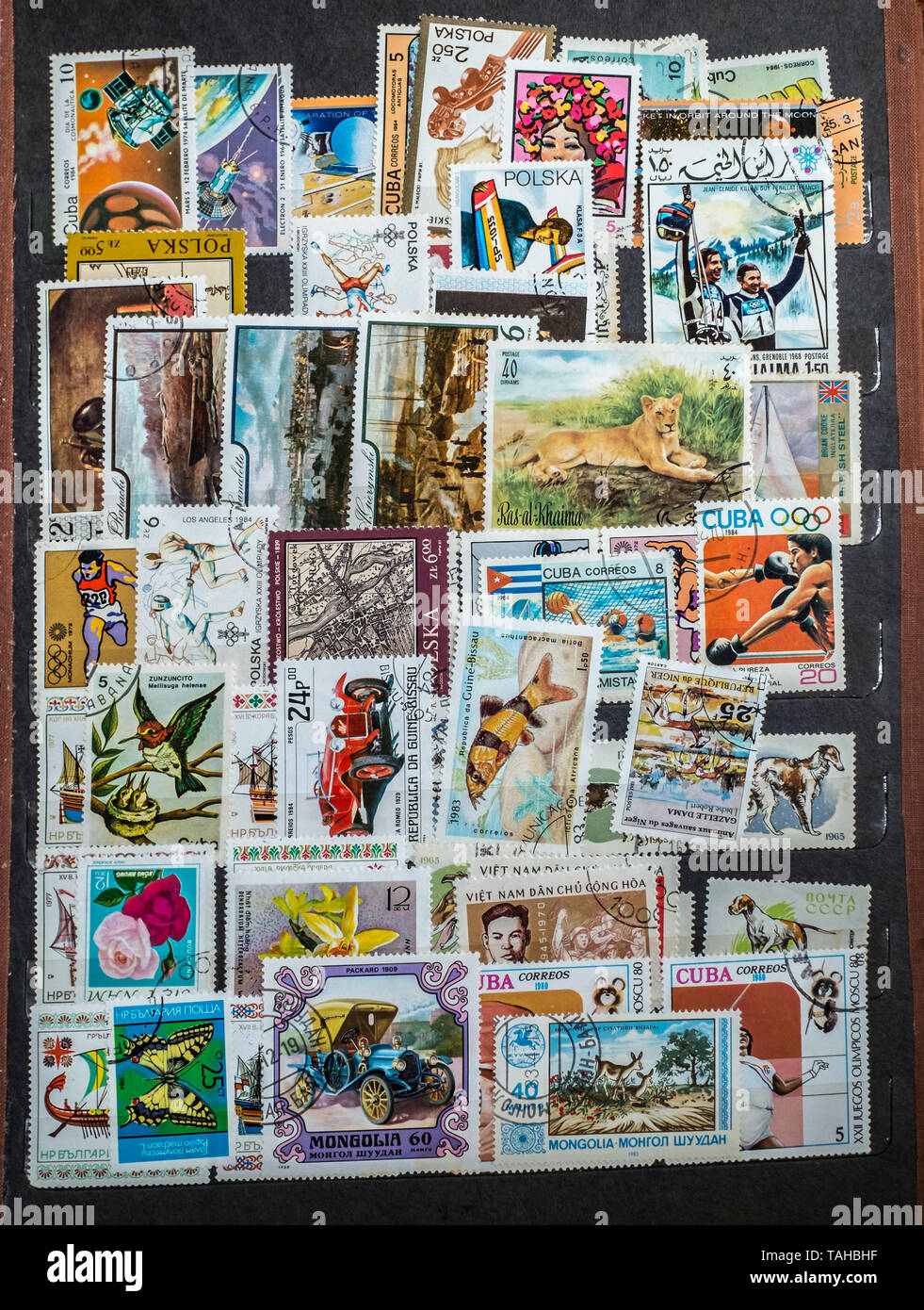 Giurgiu city, Romania - October 10, 2017. Old postage stamps arranged in the album - Stock Image