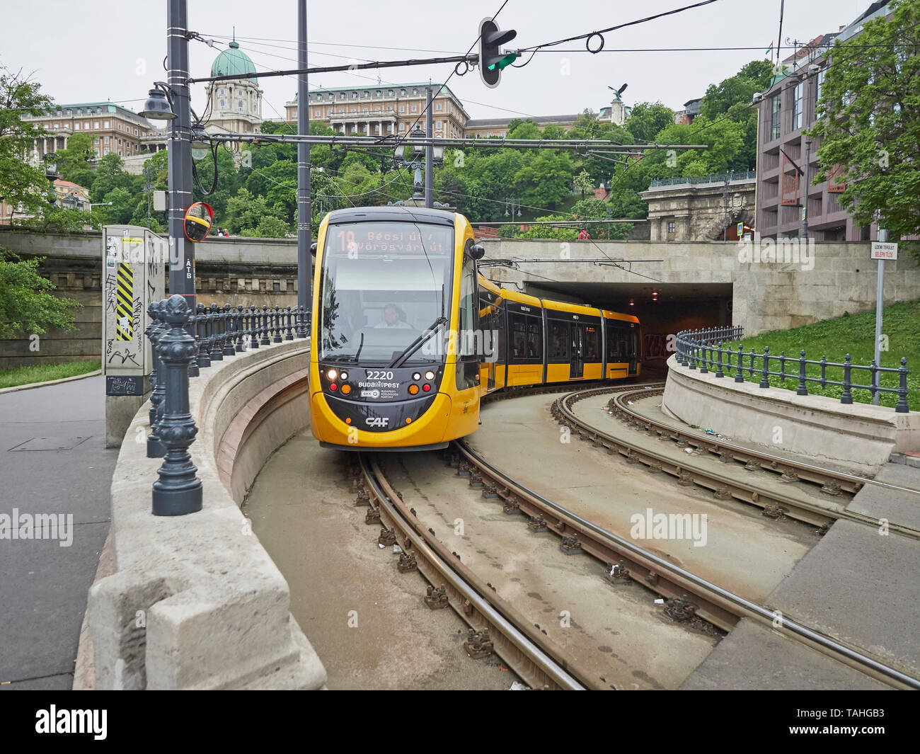 Budapest modern tram 19 along the Buda side of the Danube with Buda castle in the background Hungary - Stock Image