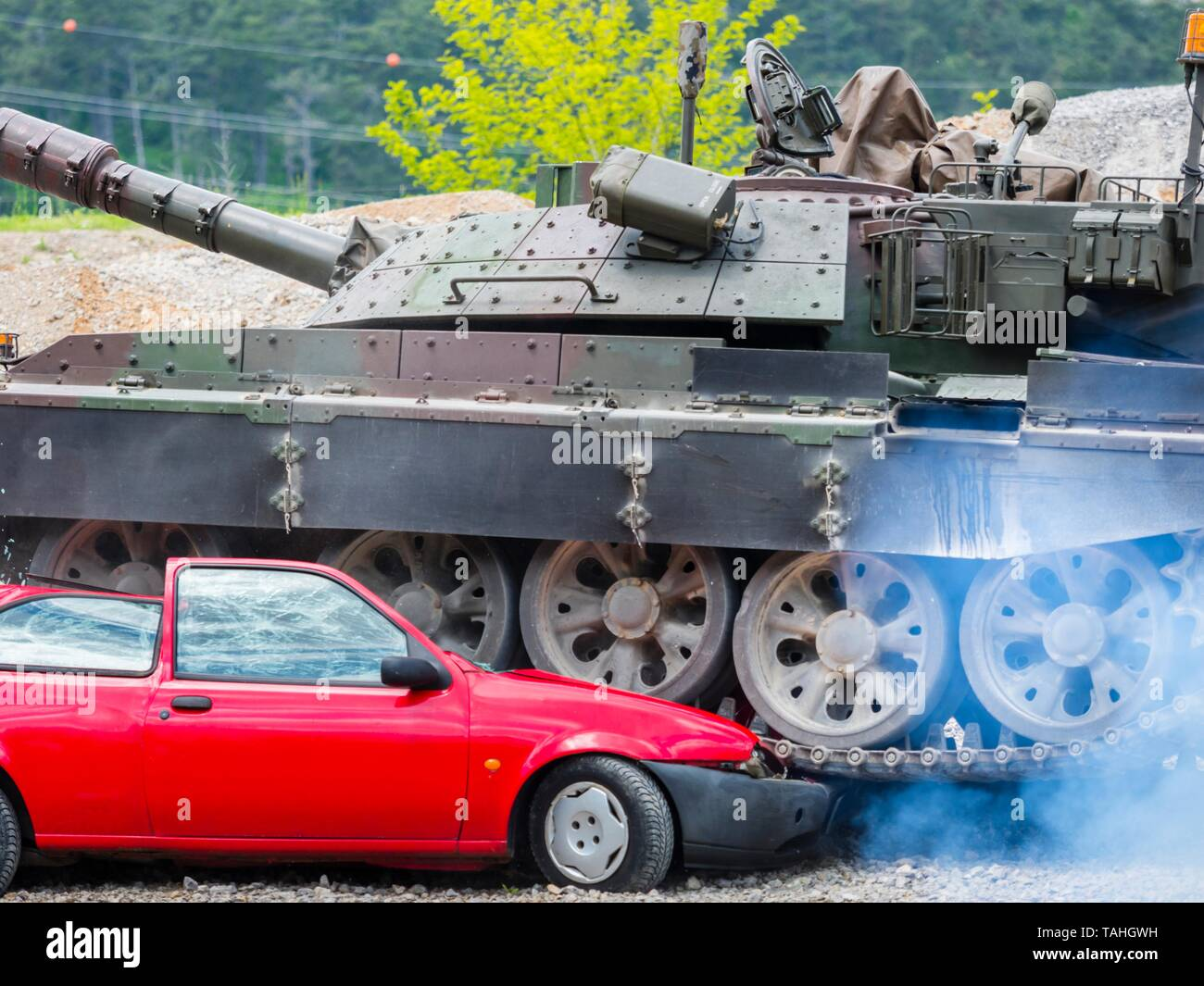 Tank crushing vehicle during public military demonstration in Pivka Slovenia Slovenian modified M-55 S tank driving side-vew close-up closeup - Stock Image