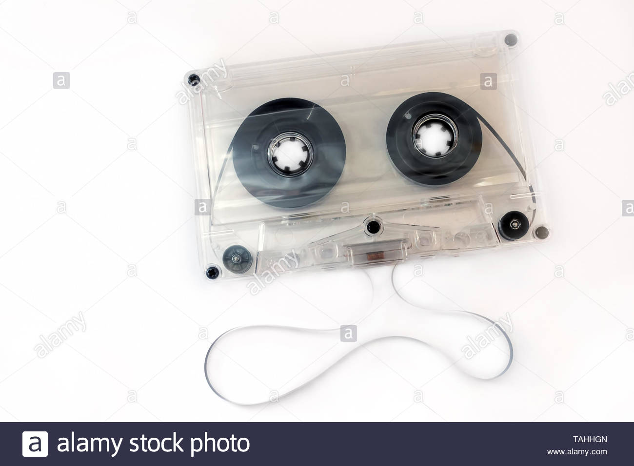 audio compact cassette with transparent body, and unwinded tape - Stock Image