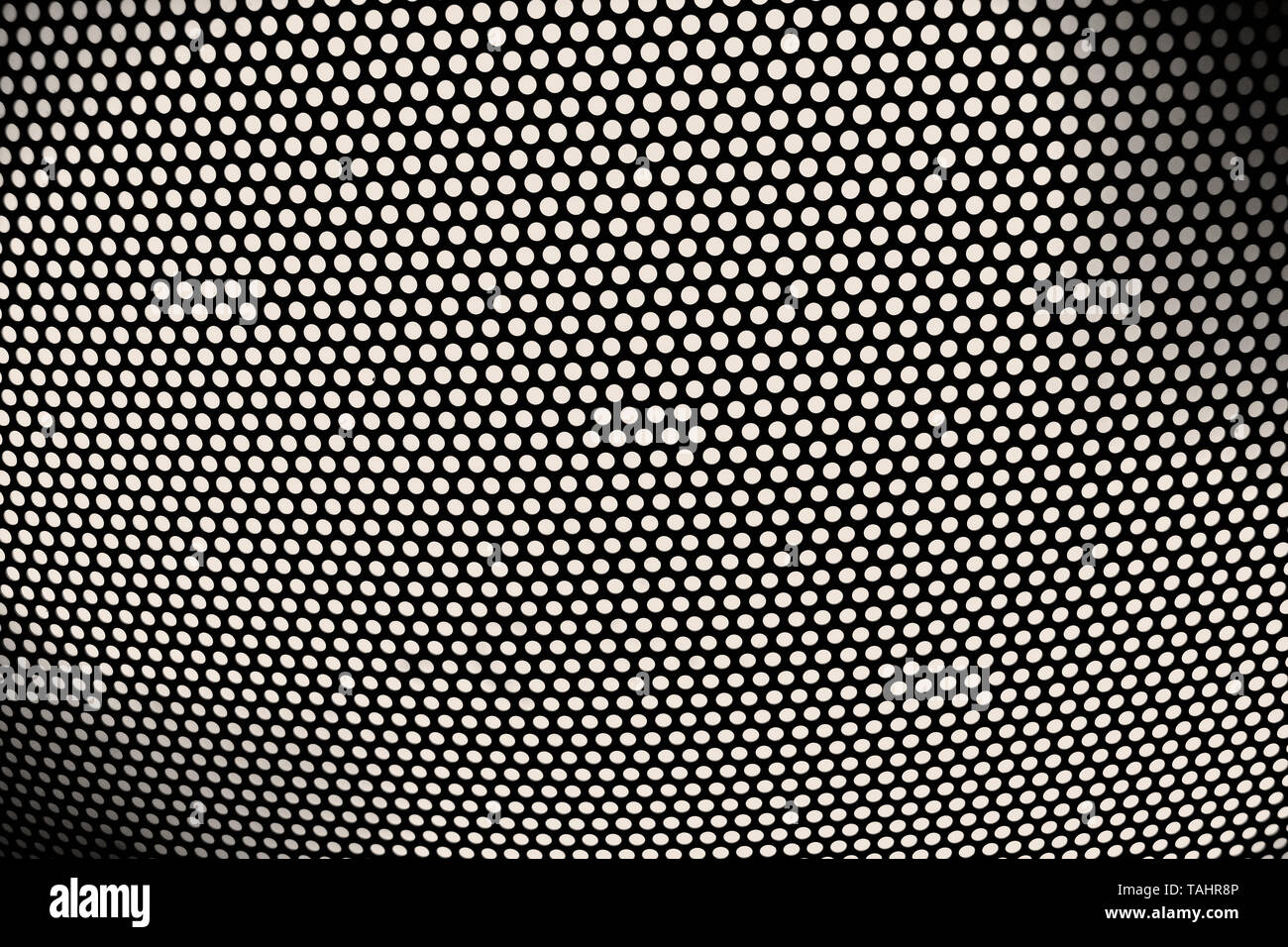 Perforated sheet as cladding on a lamp - Stock Image