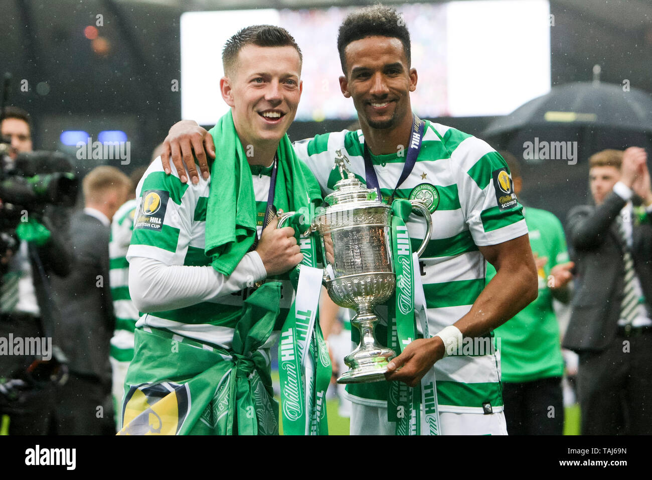 Glasgow, Scotland, May 25th 2019. Callum McGregor of Celtic and Scott Sinclair of Celtic with the Scottish Cup after the William Hill Scottish Cup final between Celtic and Hearts at Hampden Park on May 25th 2019 in Glasgow, Scotland. Editorial use only, licence required for commercial use. No use in Betting, games or a single club/league/player publication. Credit: Scottish Borders Media/Alamy Live News - Stock Image