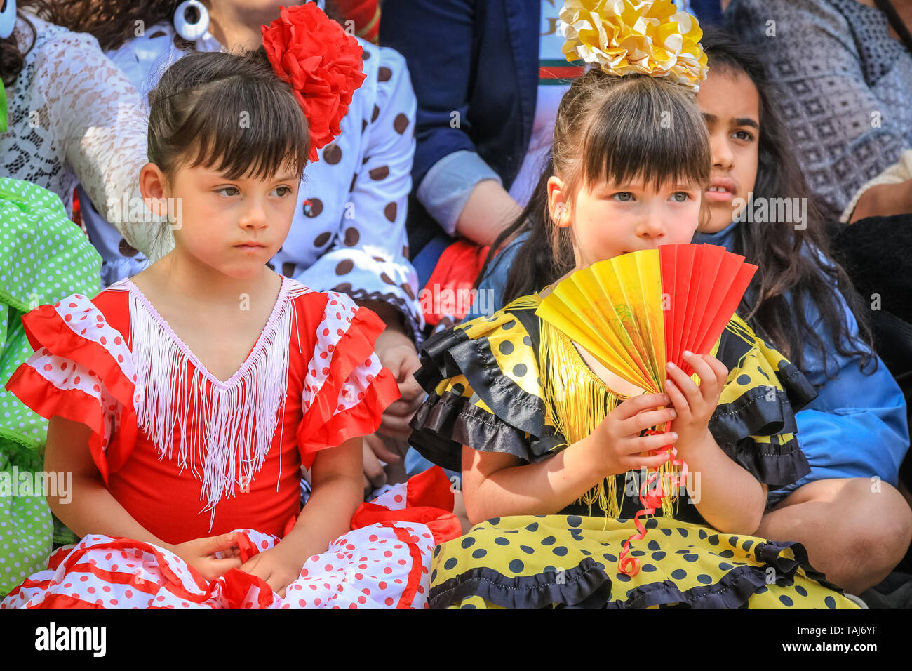 South Bank, London, UK - 25th May 2019. Children watch the performances closely. The Feria de Londres is a free festival on London's South Bank presenting Spanish culture, dance, music, wine and food from May 24-26. Credit: Imageplotter/Alamy Live News - Stock Image