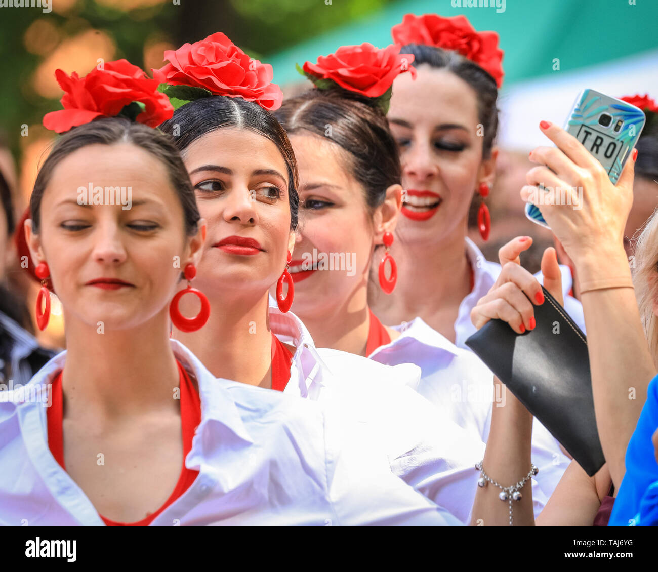 South Bank, London, UK - 25th May 2019. Viva La Feria - dancers from by Illusion Flamenco School in London passionately perform in different traditional outfits. The Feria de Londres is a free festival on London's South Bank presenting Spanish culture, dance, music, wine and food from May 24-26. Credit: Imageplotter/Alamy Live News - Stock Image