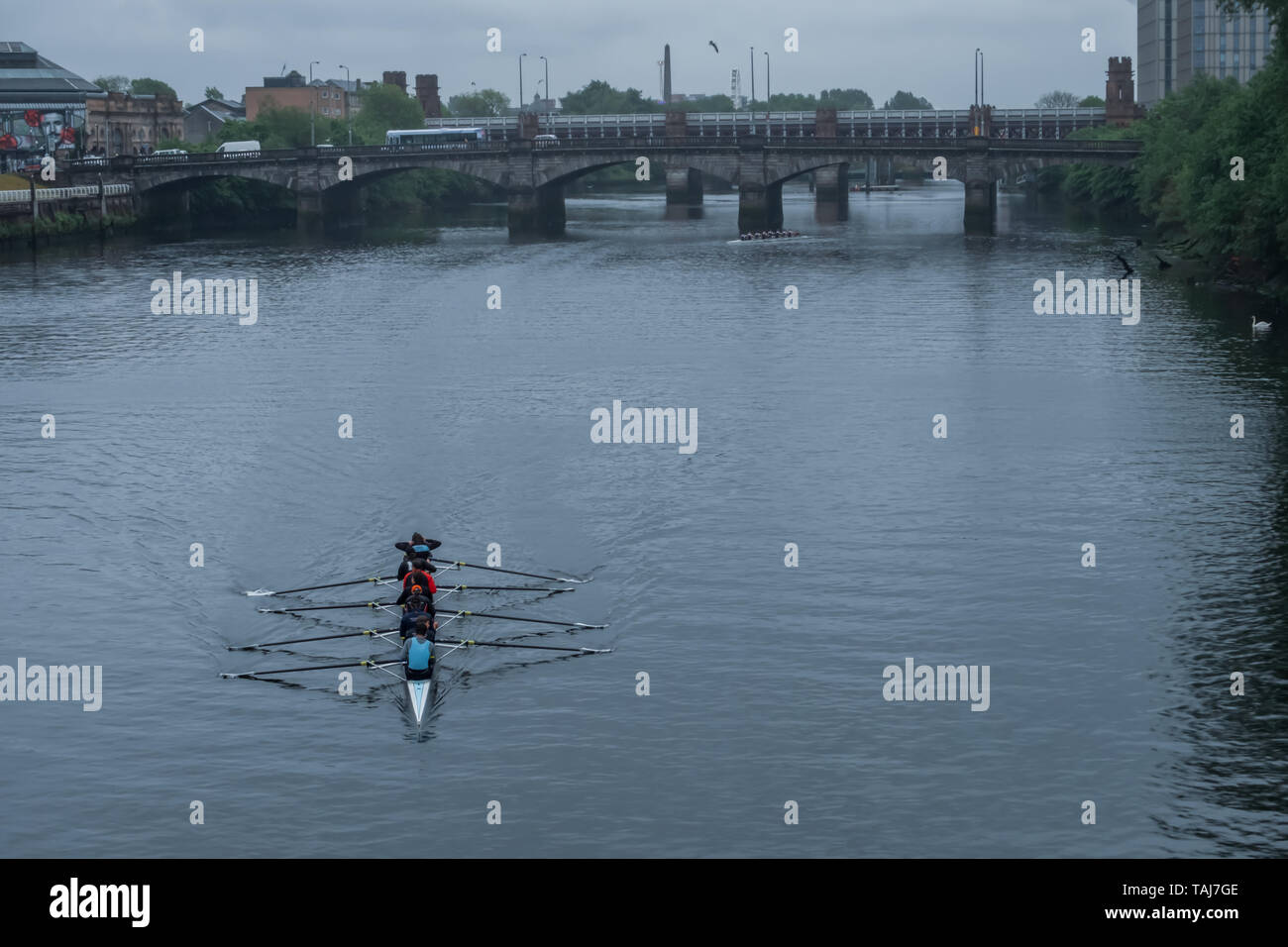 Glasgow, Scotland, UK. 25th May, 2019. The Scottish Boat Race is an annual rowing race over 2km on The River Clyde between the University of Glasgow Boat Club and the University of Edinburgh Boat Club. The race starts at the South Portland Street Suspension Bridge and finishes at the Glasgow Science Centre Tower. The event consists of six different races:  a mixed graduate, a men's novice & second eight, a women's novice & second eight, men's first eight, women's first eight and an ergometer team race. Credit: Skully/Alamy Live News Credit: Skully/Alamy Live News Stock Photo
