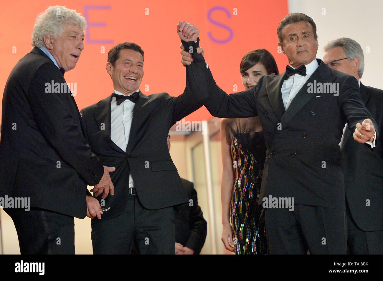 Avi Lerner (l-r), producer, David Lisnard, the Mayor of Cannes, and Sylvester Stallone attend the screening of 'Rambo V: Last Blood' during the 72nd annual Cannes Film Festival at Palais des Festivals. | usage worldwide - Stock Image